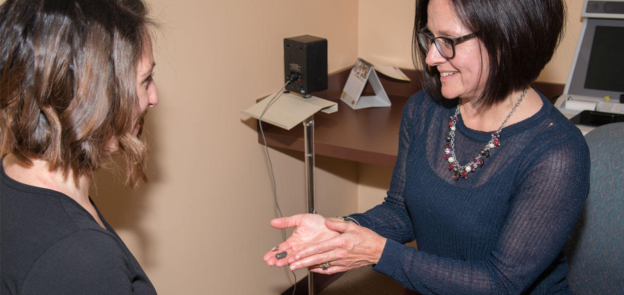 patient receiving hearing aids at Johnstown Hearing